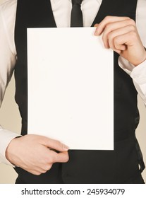business man holding a poster. place for text. template for text
