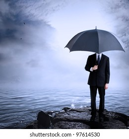 Business Man Holding Umbrella at the Coast After or Before a Storm
