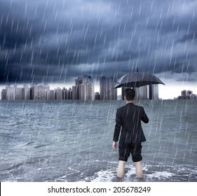 business man holding an umbrella and standing  with cloudburst background
