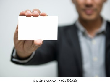 Business man holding white business card