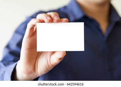 business man holding white business name card - clipping mask inside