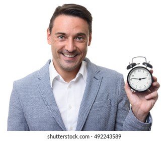 business man holds an alarm clock. Time to work concept. isolated on white background