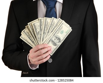 Business man holds lot of money isolated on white