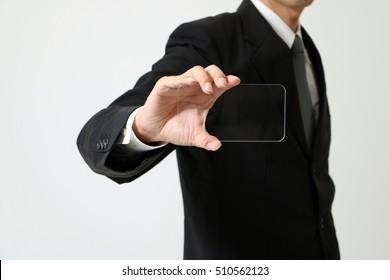 business man holds transparent panel like smart phone