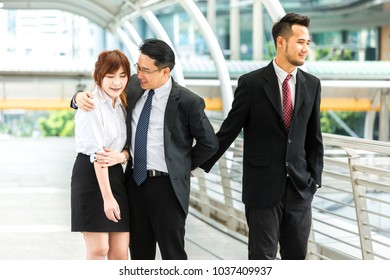 business man hug woman while hold another men hand. complicate love concept