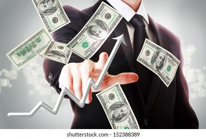 Business man with hundred dollar bills and rising arrow