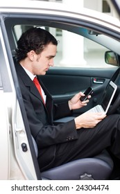 business man inside a car