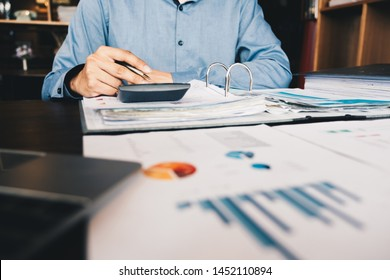 Business man investment consultant analyzing company annual financial report balance sheet statement working with documents graphs. Concept picture of business, market, office, tax.