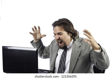 Business man isolated on white getting angry at the laptop