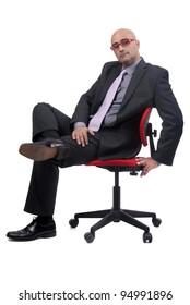 Business man isolated in white background sitting on a chair