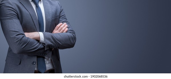 Business man in a jacket on a gray background