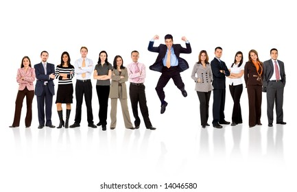 business man jumping with his business team formed of young businessmen and businesswomen standing over a white background with reflections