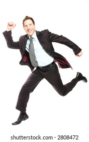business man is jumping while smiling, slight blur on face to depict motion