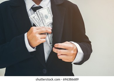 Business man keeping money Dollar bills. Saving concept