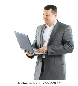 Business man with laptop on background of office