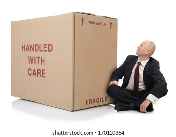 business man with a large cardboard box over a white background