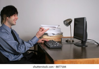 Business man laughing at computer