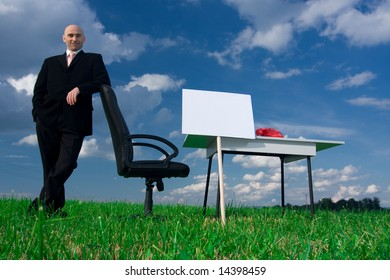 Business man leaning on a chair in an outdoor office.  Blank sign for copy.Available space for text.