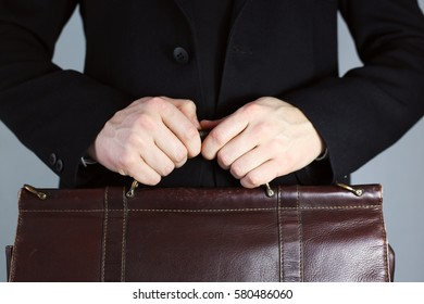 business man with a leather bag. Black suit