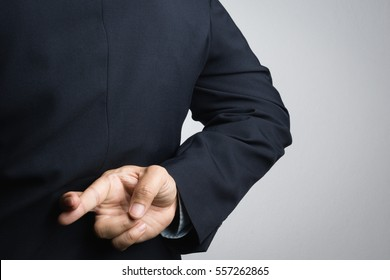 Business man with lie hand sign on white background