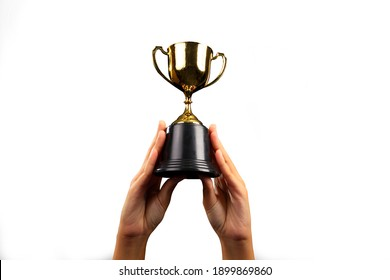 Business man lift up and hold the gold trophy against whie background with clipping path
