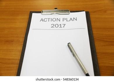 Business man list Action plan 2017 on Desk Office