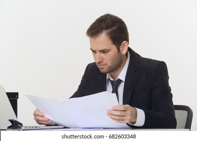 Business man looking at analytical statistics on working desk