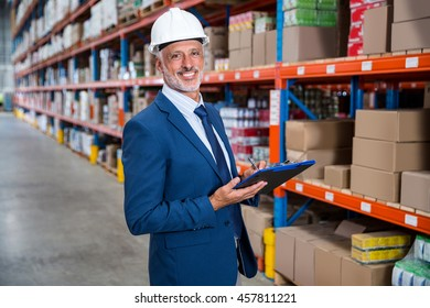 Business man looking the camera in a warehouse