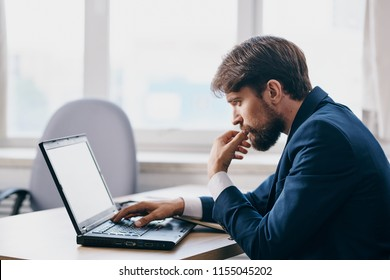 business man looking at laptop
