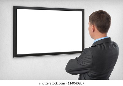 Business man looking on the empty screen