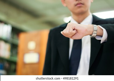 business man looking on hand watch