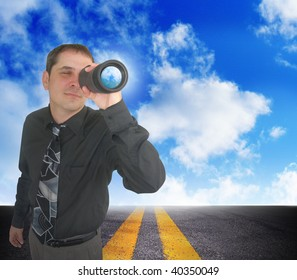 A business man is looking through binoculars. There are clouds behind him and a road. Can represent the future and planning ahead or a strategy and a discovery of an idea.