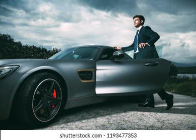 Business man in luxury car - Shutterstock ID 1193477353