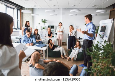 Business man makes a presentation in the office standing behind