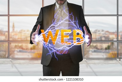 Business man making electricity light word WEB from his hands concept