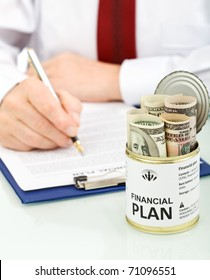 Business man making financial plan with an opened can of dollars - conceptual, closeup