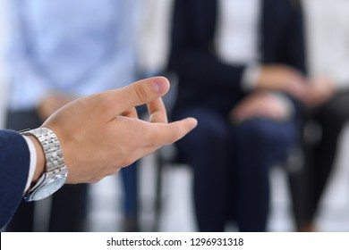 Business man making presentation to group of people. Speaker delivering a seminar to his colleagues or business training. Teamwork and coaching concept