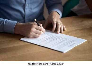 Business man manager customer hand sign contract, male client put written signature on legal paper subscribe document fill form make sale purchase commercial insurance deal agreement, close up view