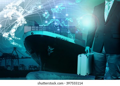 business man and metal briefcase in hand standing against shipping port