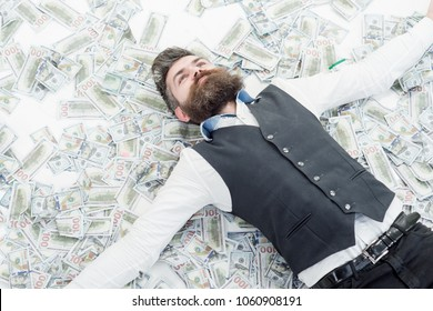 Business man, millionaire, billionaire, bearded man with many banknote. Business man lying in banknotes. Bank concept. Saving money concept. Business concept.