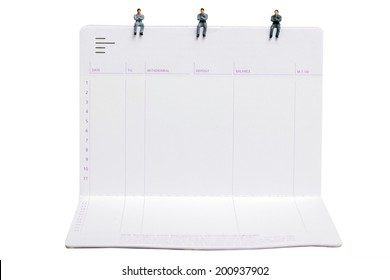 business man miniature figure sit down on passbooks concept idea to success white background with clipping path