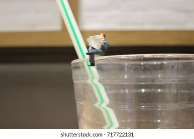 business man miniature mini figure sit and read newspaper