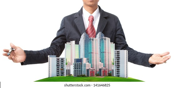 business man and modern building on green grass field use for land management theme