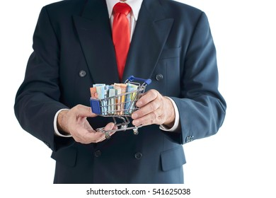 Business man with Money in Shopping cart