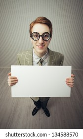 Business man nerd holds a blank sign, ready for your text, old style image