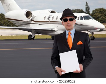 Business man next to a private jet