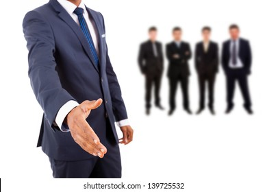 Business man offering handshake with businesspeople people on background