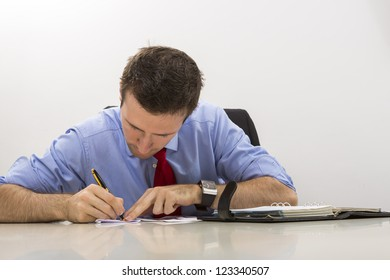 Business man at office filling paper documents.