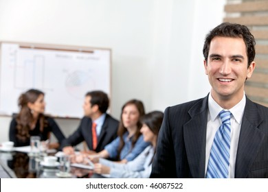 Business man at the office with a group behind