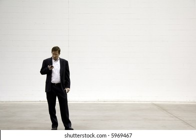 Business Man on Blackberry Phone against White Background